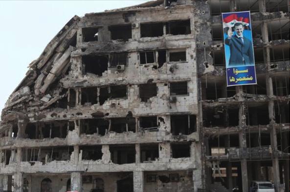 Homs we will rebuild it together Sam dagher WSJ