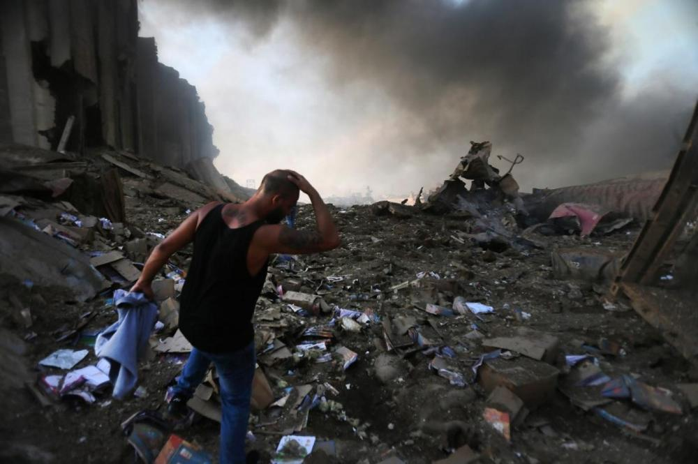 La double explosion dans le port de la capitale libanaise Beyrouth le 4 août 2020 a fait au moins 220 morts et 6 000 blessés (AFP)_0